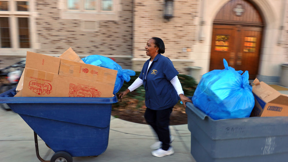 Building Services personnel remove recyclables from campus buildings.