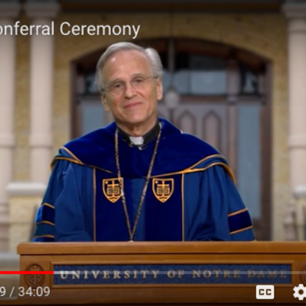 University of Notre Dame President Rev. John I. Jenkins, C.S.C., as seen on computer monitors during the livestream of the degree conferral ceremony. The event was recorded and later posted on YouTube.