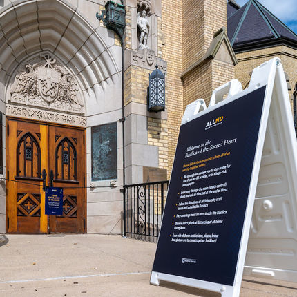 Signs at the east door of the Basilica of the Sacred Heart direct Mass attendees to the main doors of the church. (Photo by Matt Cashore/University of Notre Dame)