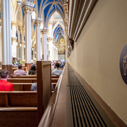 Signs on the wall of the Basilica of the Sacred Heart remind Mass attendees of physical distance guidelines in response to the coronavirus. (Photo by Matt Cashore/University of Notre Dame)