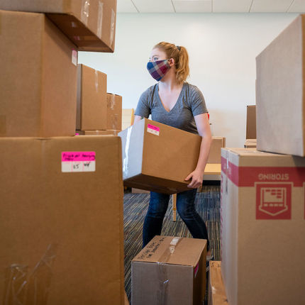 Abigail Amat unpacks boxes at the new Robinson Community Learning Center (RCLC) in South Bend. (Photo by Barbara Johnston/University of Notre Dame)