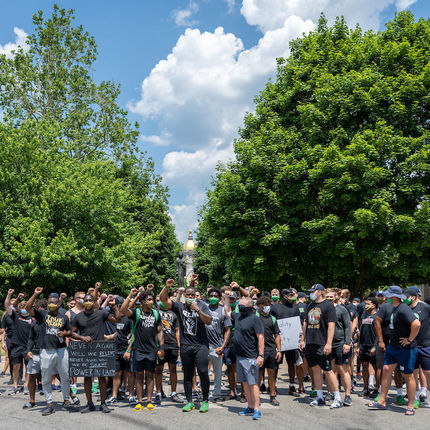 Members of the Notre Dame football team pause in the main circle. Team members organized a rally and walk for the campus community in recognition of Juneteenth. (Photo by Matt Cashore/University of Notre Dame)