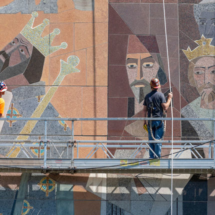 "Workers from C&S Masonry Restoration, LLC, Bryan Gundlach (left) and Steve Bryan do preventive maintenance on the ""Word of Life"" mural on the south side of the Hesburgh Library. (Photo by Barbara Johnston/University of Notre Dame)"