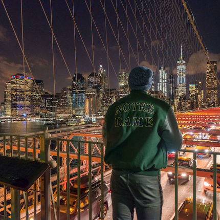 November 8, 2017; A junior civil engineering student, Adam Kuczynski, takes in the view from the Brooklyn Bridge on the first day of the 2017 Department of Civil and Environmental Engineering and Earth Science, (CEES), Junior Class field trip to New York City. (Photo by Barbara Johnston/University of Notre Dame)