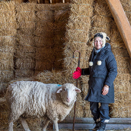 February 3, 2017; SuzAnne Akhavan-Tafti, '91M.A. with her favorite sheep, Baby a 5-year old wether that has earned permanent residency at Full Circle Organic Farm in Howell, Michigan. (Photo by Barbara Johnston/University of Notre Dame)