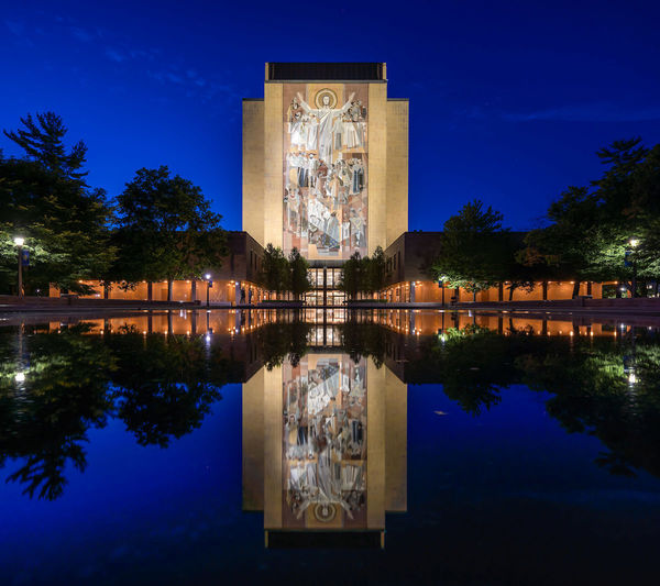 Hesburgh Library at dusk