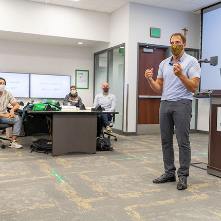 Pictured is MSBA faculty member Greg Hedges teaching the class Emerging Issues. Hedges created and chairs the Notre Dame Executive Business Council in Chicago and is a founding Managing Director of global consultancy Protiviti. (Photo by Barbara Johnston/University of Notre Dame)