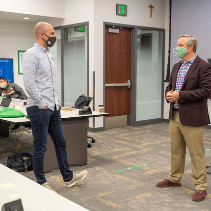 Students enrolled in Mendoza's Master of Science in Business Analytics program meet in-person for classes on campus the week of July 20. Pictured on right is Information Technologies Teaching Professor Mike Chapple. (Photo by Barbara Johnston/University of Notre Dame)