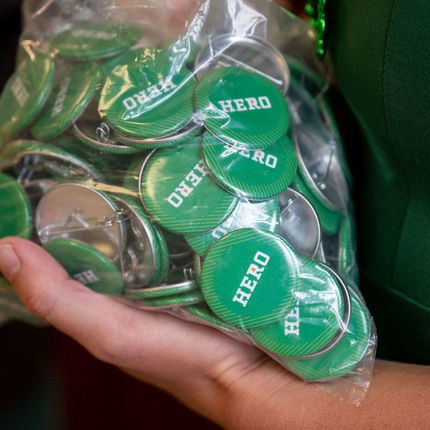 The UEE leaders passed out Hero buttons to everyone they encountered. (Photo by Matt Cashore/University of Notre Dame)