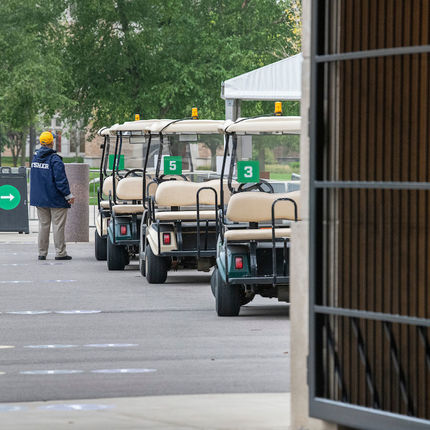 Golf carts wait to take students to isolation locations if needed. (Photo by Barbara Johnston/University of Notre Dame)